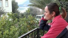 Troubled woman at the balcony Stock Footage