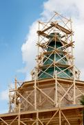 Stock Photo of erection of the tent a wooden church