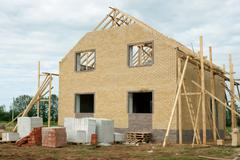 brick house under construction - stock photo