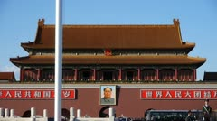 Chinese red flag flutters in wind.Beijing Tiananmen Square plaza Street,traffic Stock Footage