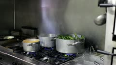 Cooking of food in pots Stock Footage