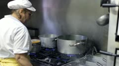 chef cooking risotto in a italian seafood restaurant - stock footage