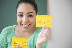 Hispanic teacher using flash cards Stock Photos