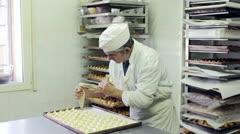 Pastry chef preparing cream puff Stock Footage