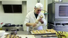 Baker preparing cream puff Stock Footage