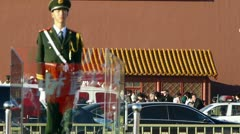 Guard Soldier on Beijing Tiananmen,China socialist red wall.Street traffic. Stock Footage