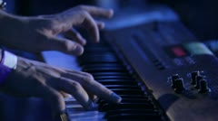 Hands playing music on the piano keyboard on rock concert Stock Footage