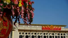 Baskets full of flowers.Beijing Tiananmen Square & national emblem of China. Stock Footage