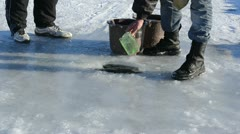 Man draw water ice hole pour bucket winter skate site prepare Stock Footage
