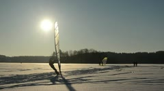 Ice sailer surf frozen lake snow wonderful sunset modern hobby Stock Footage