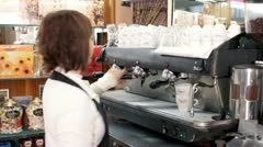 making coffee espresso in a bar with professional machine - stock footage