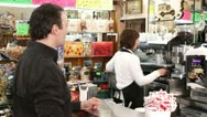 Stock Video Footage of bartender prepares a cup of coffee for a customer