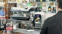 barista prepares a cup of coffee espresso  for a customer - stock footage