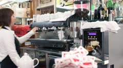 Barista female making a coffee with professional machine - dolly Stock Footage