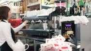 Stock Video Footage of barista female making a coffee with professional machine - dolly