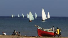 People and fishing boats on Cape Verde - stock footage