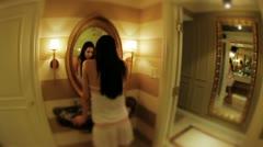 Walking to mirror, woman walking towards mirror Stock Footage