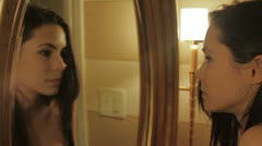 Girl in Mirror, girl looking at her reflection Stock Footage