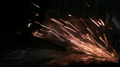 Sparks flying in the dark. - stock footage