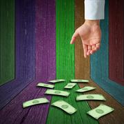 hand and falling money - stock photo