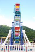 A colourful ferris wheel Stock Photos