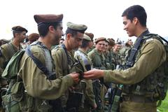 Golani recruits receive brown beret Stock Photos