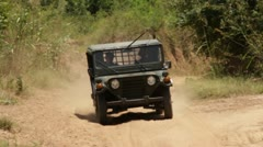 MILITARY: Vintage 1970 US Army Jeep Approaches in Asia Stock Footage