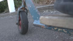 Retro push scooter POV downhill sidewalk Stock Footage