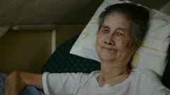Old woman resting at home Stock Footage