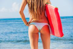 Young bbeautiful in bikini at the beach with boogie board Stock Photos