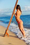 Beautiful surfer girl in sexy bikini Stock Photos