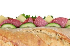 top view of a baguette with salami - stock photo