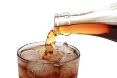 cola pouring into a glass - stock photo