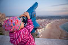 girl looking at nazare - stock photo