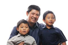 smiling father and sons - stock photo