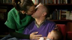 Family portrait, adult couple playing with little baby at home Stock Footage