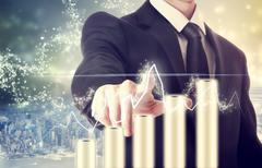 businessman with graph representing growth - stock photo