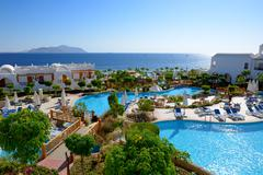 the beach with swimming pools at luxury hotel, sharm el sheikh, egypt - stock photo