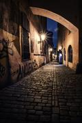narrow alley with lanterns in Prague at night - stock photo