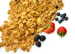 Bran and raisin cereal with fruits and berries Stock Photos