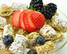 Shredded wheat cereal with fruits and berries Stock Photos