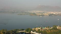 Pan landscape with lake and palaces in Udaipur India Stock Footage