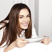 Stock Photo of beautiful smiling woman with tablet