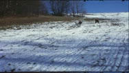 Vintage 8mm film: Children on sledge, 1960s Stock Footage