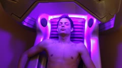 Spa, boy tanning solarium Stock Footage