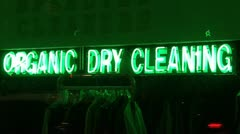 Organic Dry Cleaning Neon Sign And Drycleaning On Rack Stock Footage