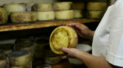 Whole cheese and oil. Stock Footage