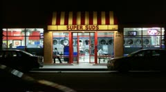 Super Suds Laundromat At Night Stock Footage