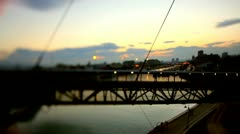 Walking on a bridge in the sunset. - stock footage