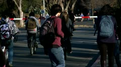 College students on busy campus California High Definition video stock footage Stock Footage